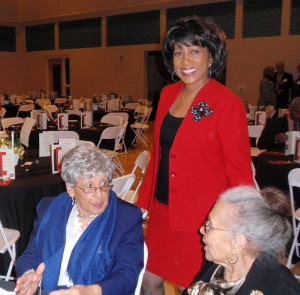 Diana Robinson Lewis checks in with her mother, Doris Spann (right), and her aunt, before the program.