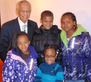 Dr. C.T. Vivian (from top left, clockwise) appears with some of the younger members of the audience: Breon Lopp, Amina Lawson, Taylar Pulliam, and Maia Lawson.