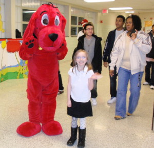 Seven-year-old Faith Munn, a student at King's Elementary, poses with Clifford, the big red dog.