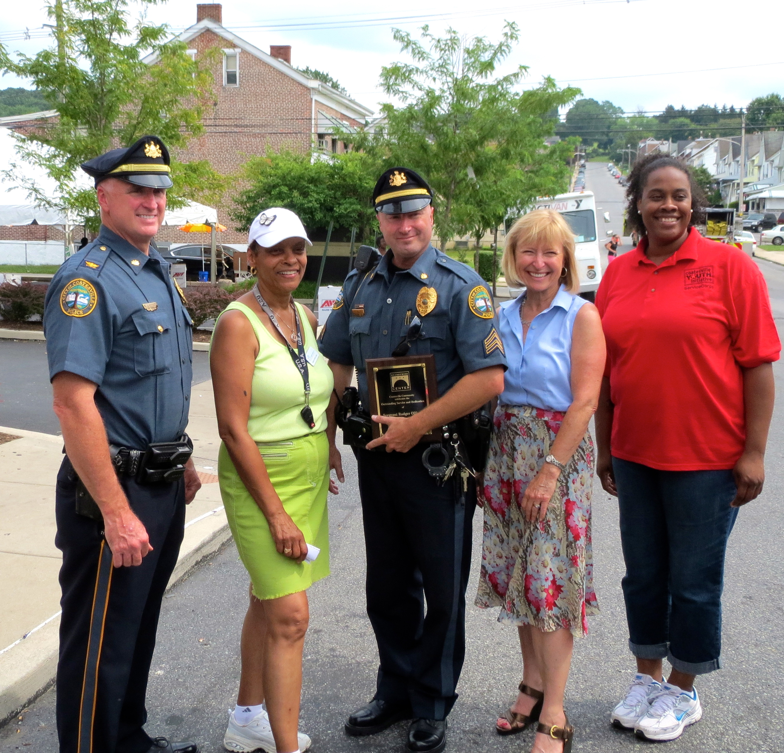 Coatesville Police Chief Jack Laufer (from left), Chester County Community Dental Executive Director Regina Horton Lewis, Coatesville Sgt. Rodger Ollis Jr., Brandywine Health Foundation CEO Frances Sheehan and Coatesville Youth Initiative Chaya Scott celebrate Ollis' award.