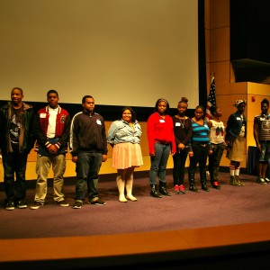Bridge Academy students receive a standing ovation from the 150 attendees.