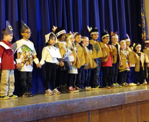 Kindergarten students from Caln Elementary take the stage as Pilgrims and Indians.