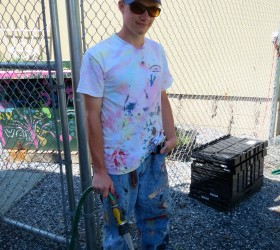 Proving that he's not afraid to get his hands - or his clothes dirty - Chasan Hall cleans up after working on a mural at Waste Recyclers, where he worked during the summer for the Coatesville Youth Initiative's ServiceCorps.