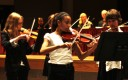 The 7th and 8th Grade String Ensemble performs at Tuesday night's school board meeting.