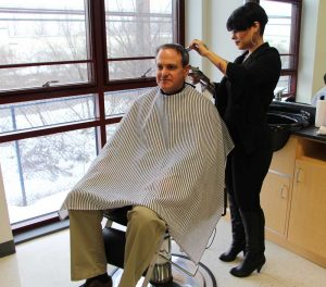 Jessica Hernandez gives barbering instructor Drew Givler a haircut in ...
