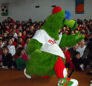 The Phillie Phanatic demonstrates some of his dance moves during an assembly at Friendship Elementary School.