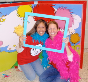 """""""Reading Across America"""" organizers Michelle Ollis (left) and Traci Tury demonstrate one of the photo opportunities for participants."""