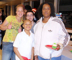 Chaya Scott (right), who heads the Coatesville Youth Initiative, is surrounded by enthusiastic program participants: Samaria Turner (from left), 15; her son, Amon Scott Hicks, 9; and Nelson Negron, 14.