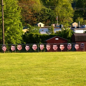 Coatesville celebrated senior night on Tuesday with pictures of the senior along the first base line.