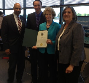 Ruth E. Kranz-Carl holds a certificate of commendation she received from Commissioner Terence Farrell (from left), Commissioners' Chairman Ryan Costello, and Commissioner Kathi Cozzone.