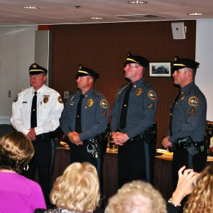 Lt. James R. Audette, Sgt. Roger H. Ollis, Jr., Corp. Brenden M. Boyle, and Corp. Jonathan A. Shave stand in front of friends and family after taking their oaths of office.