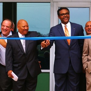 City Manager Kirby Hudson and Lincoln University Provost Dr. Kenoye Eke cut the ribbon on the steps of Gordon Education Center.
