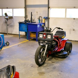One of many student projects sits in the Learning Center small engines shop. Students fused an obsolete tractor with an obsolete motorcycle to make a working hybrid.