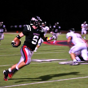 Tyler Burke takes a punt to the house.  Burke caught the short kick after it was partially blocked by Danny Glass.