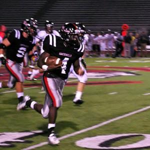 Daquan Worley races past the defense after looking like he would be stopped at the line.