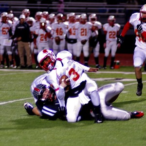 Tyler Burke makes a first quarter sack. Burke, who has been Coatesville's best defensive player all year, went on to return an interception for a touchdown.