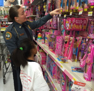 Coatesville Det. Shannon Smith offers assistance to her shopper in the Barbie section.