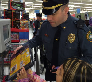 Coatesville Cpl. Jonathan Shave offers assistance to his shopper at the price-checker.