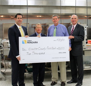 First Niagra's Allan Burkley (from left) poses with Robert MacNeil, board chairman of the Chester County Food Bank; Larry Welsch, its executive director; and Bob Kane, First Niagara's eastern Pennsylvania regional president.