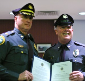 Police Chief Jack Laufer (left) stands with Ofc. Joseph Thompson (right) after Thompson's swearing in ceremony.