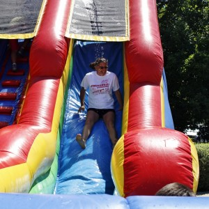 City Council Member Marie Hess cools down on the water slide.
