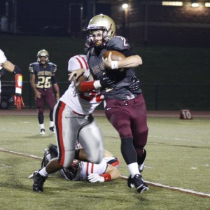 Davon Simpson sacks the quarterback in the second quarter. Coatesville's defense looked strong all over.
