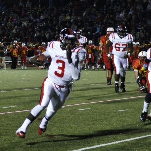 Jordan Young keeps for a 22-yard touchdown run in the first quarter.