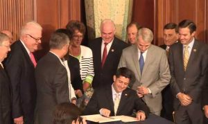 Congressman Meehan looks on as Speaker Paul Ryan signs the Comprehensive Addiction and Recovery Act to send it to the President's desk on July 14, 2016